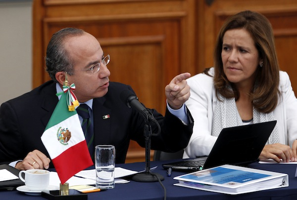 Mexico's President Felipe Calderon, gesture during a meeting with victims of violence in Mexico City, Thursday June 23, 2011. At right is his wife, Margarita Zavala. Calderon says he doesn't regret his strategy to fight organized crime, despite calls to end a confrontation that has killed at least 35,000 during his administration.(AP Photo/Eduardo Verdugo)