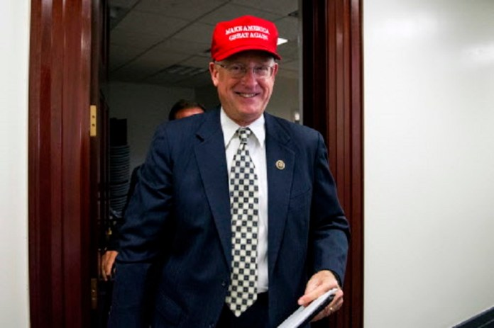 """FILE - In this Nov. 15, 2016, file photo, Rep. Mike Conaway, R-Texas, wearing a """"Make America Great Again"""" hat leaves a House Republican leadership meeting on Capitol Hill in Washington. House Republicans are laying the groundwork for a fresh effort to overhaul the nation's food stamp program during Donald Trump's presidency, with the possibility of new work and eligibility requirements for millions of Americans. (AP Photo/Cliff Owen, File)"""
