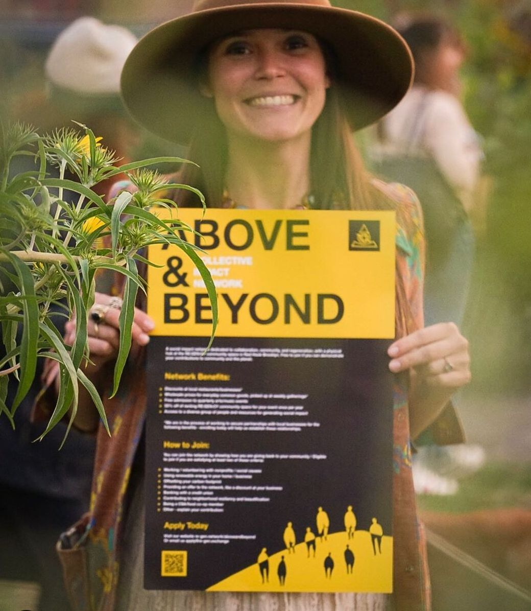 Ashley Taylor, Founder of Regency Space, display sign for the new Above and Beyond Membership Program