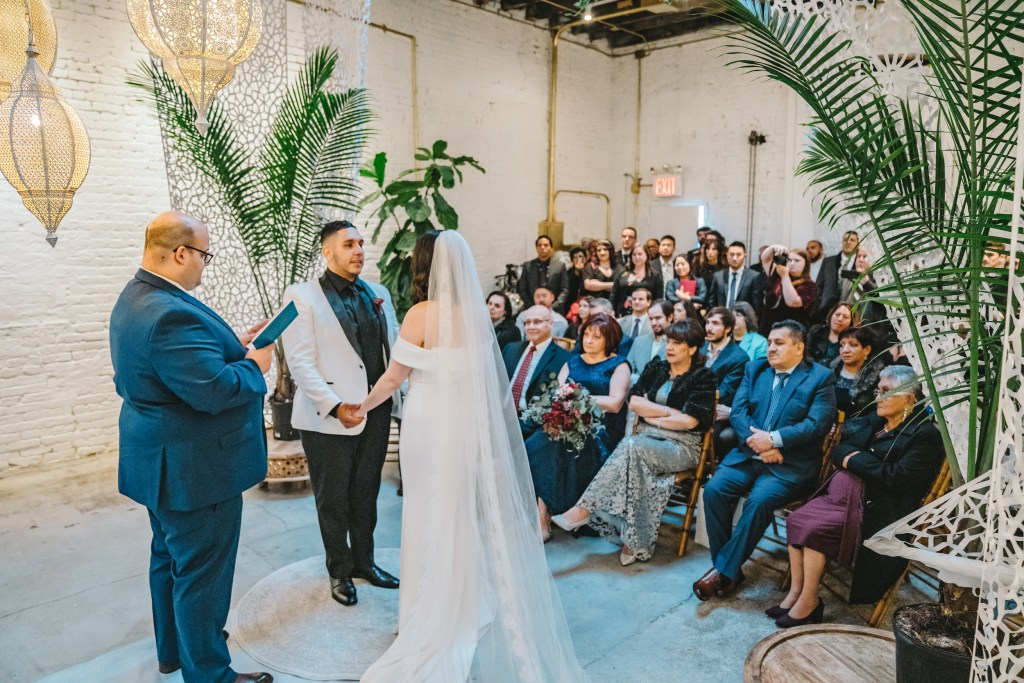 Bride in white wedding dress (@ramsojas) and groom (@rojas0_0) say vows with minister