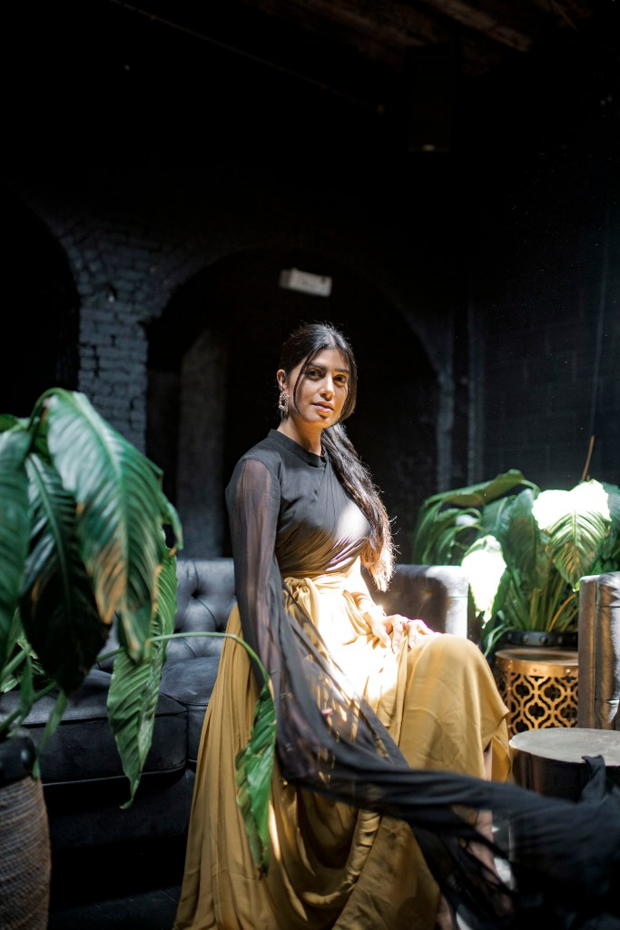 Photoshoot of model with sun beams at Regency Event Venue in Brooklyn, New York