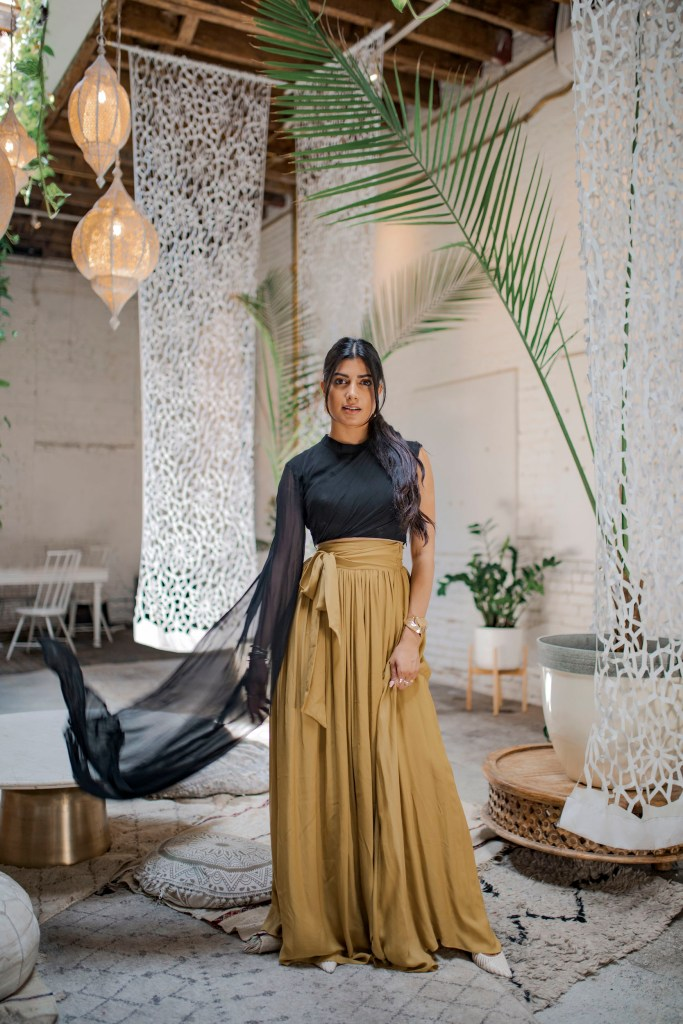 Photoshoot of model in black and gold at Regency Event Rental Space in Brooklyn, New York