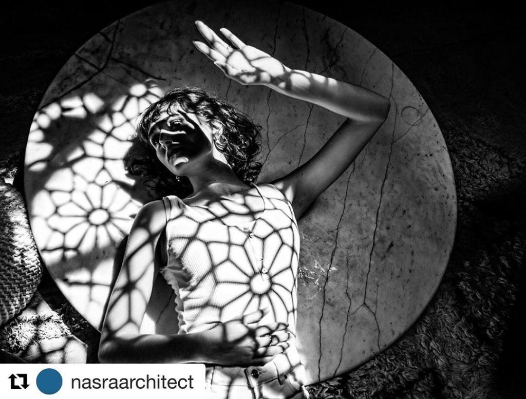 Bespoke curtains cast star-like shadows for fashion shoot at Regency
