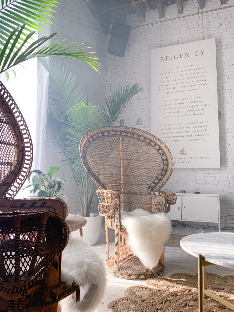 High backed chairs with fur seat and plants in the background in Regency event venue