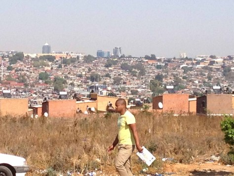 The contrast between rich and poor areas in Africa. The poor township of Alexandra in the foreground in contrasted with the rich Sandton skyline in the distance.