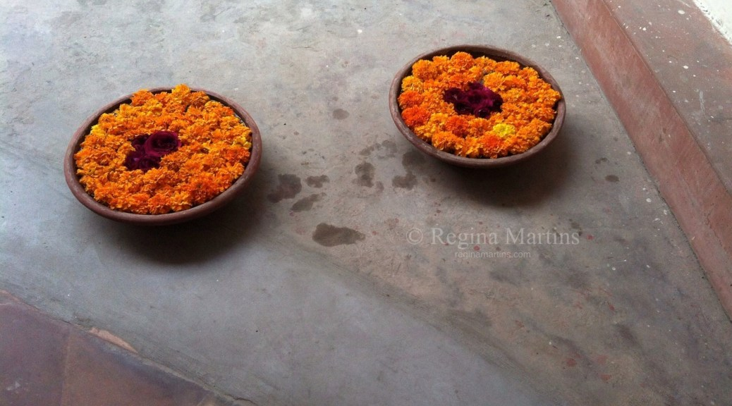 """There are flowers wherever one goes in India. Bowls of bright orange marigolds at the bottom of a stairwell. The Portuguese introduced marigolds to India. They are also known as """"The Herb of the Sun"""" and are symbolic of passion and creativity. Curtains of marigolds are strung up at Hindu weddings. Lord Vishnu and his wife Goddess Lakshmi, the ideal couple are worshiped with marigolds, hence they are auspicious at Hindu weddings, blessing the couple divine blessings and a happy and prosperous life ahead."""