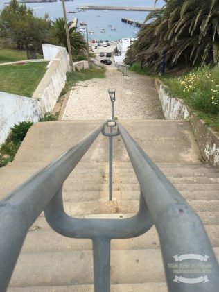 A railing to hold on to, on the steep stairs down to the Sagres harbour ©2016 Regina Martins