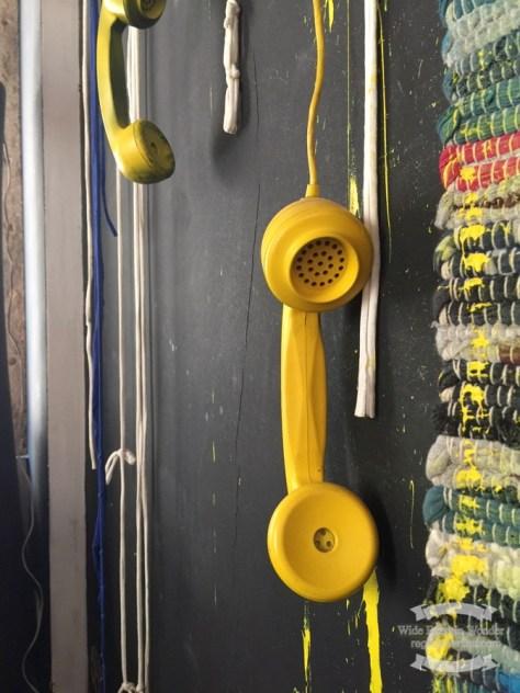 Oddball yellow phone display in a restaurant in Lisbon ©2016 Regina Martins