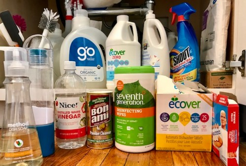 Cleaners. Plus bottle brushes, spatulas, paper towels snd trash bags. Cleaners here:  Green Shield Organic Laundry Detergent, Ecover Zero non-Chlorine Bleach; 365 Stain Remover Prewash; Shout stain remover; Mr. Clean Magic Sponge; Ecover Dishwasher Tablets (with unexpected fragrance), Seventh Generation Disinfecting Wipes, Bon Ami Powder Cleanser; Nice! White Vinegar; Arm & Hammer Baking Soda; Method Dish Soap. Hanging are three refillable spray bottles containing Biokleen BacOut Stain and Odor Remover (for pet accidents), vinegar, and water.  Please note: As a reminder, these is a transitional set.