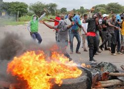 Zimbabwe chaos: Crackdown on fuel price hike protesters has forced activists into hiding.
