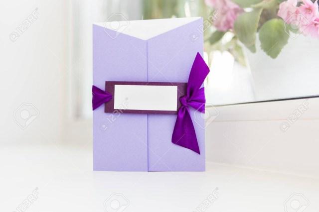 Wedding Invitations With Purple Ribbon Beautiful Handmade Wedding Invitations With Purple Ribbon Stock