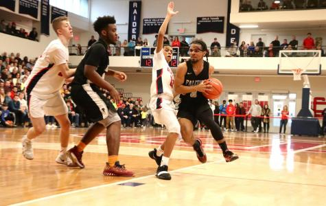 Boys Basketball Eliminated in Second Round of Tournament