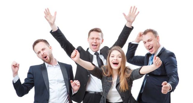 Happy business people celebrate. Photo by Shutterstock