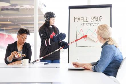 Three Canadians in an Office Discuss Maple Syrup Supplies