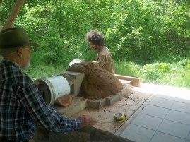 Making the sand igloo.