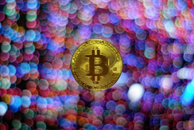 pictures shows a bitcoin as we talk about crypto developments such as defi and others