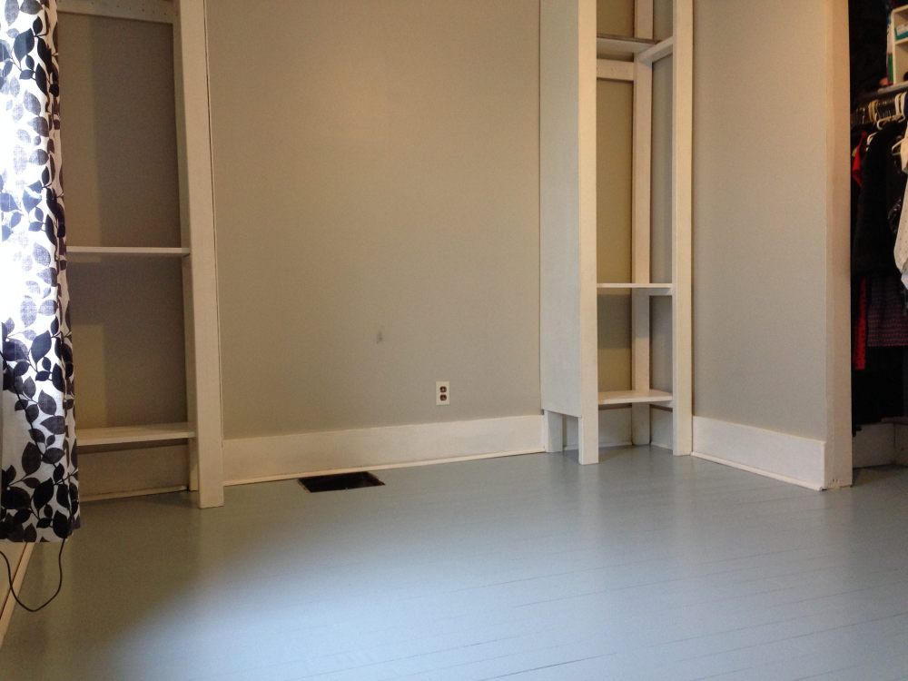 Refinished bedroom floors with paint.