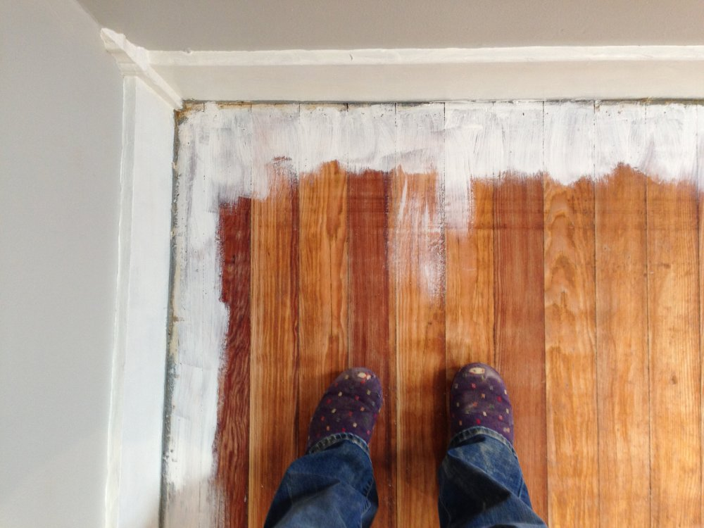 How to prime wood floors for paint.