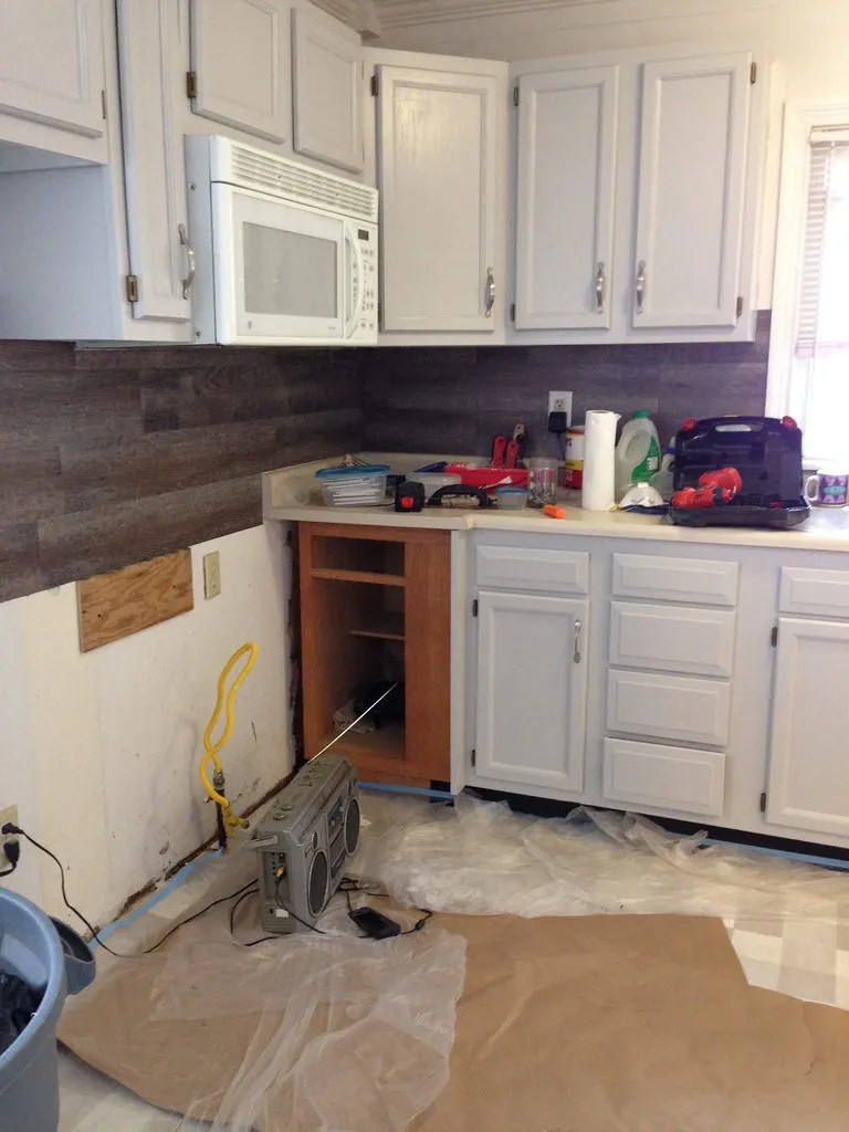 DIY kitchen cabinet painting.