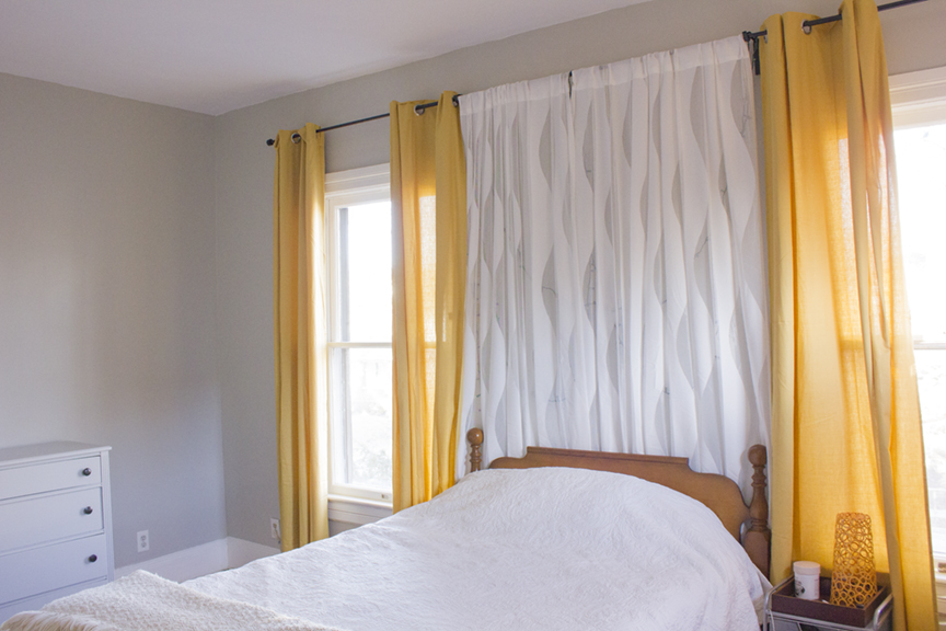 White Bedspread, Yellow Curtains, Gray Walls, And Sheer Curtains With  Lights Behind The