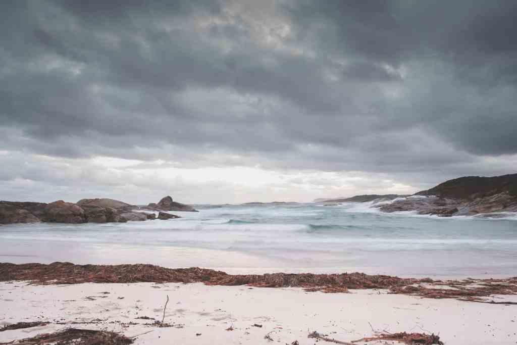 lonely snowy coast of wavy ocean