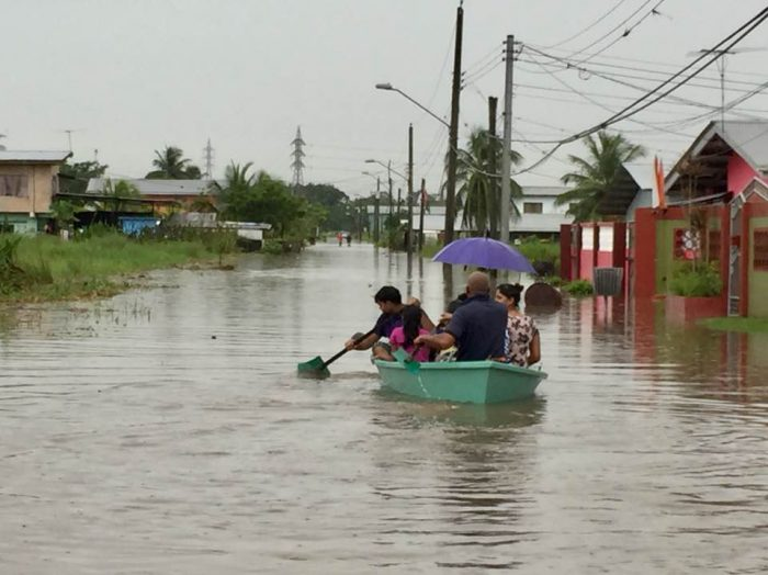 The failure of the ODPMTT left thousands affetce dby floods. Here a family uses a boat to traverse the deep flood waters.