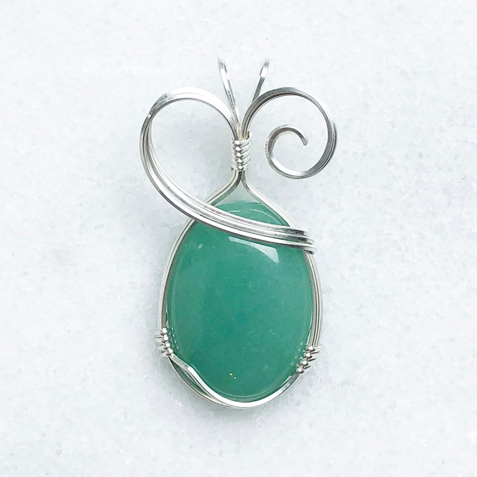 reiki charged green aventurine pendant