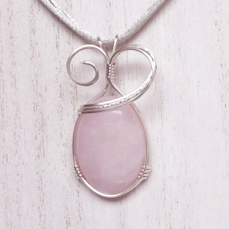 reiki charged rose quartz pendant