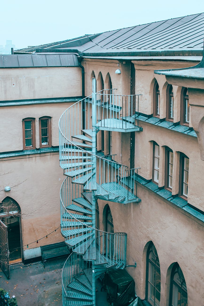 residential building with outdoor spiral staircase