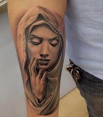 http://tattoosuppliesonline.blogspot.co.uk/2013/04/religious-tattoos-design-ideas.html