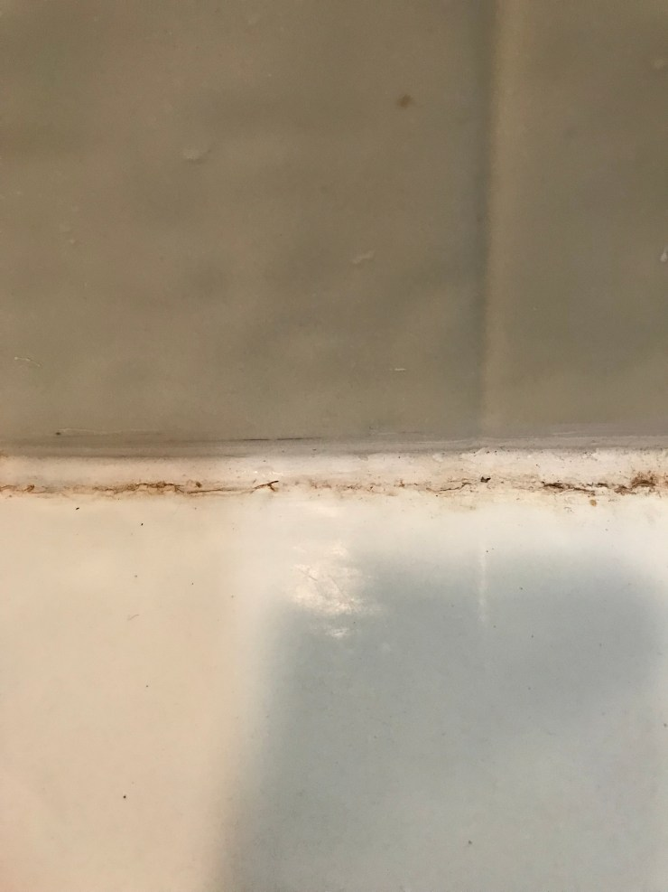 Old Caulk Around Bathtub