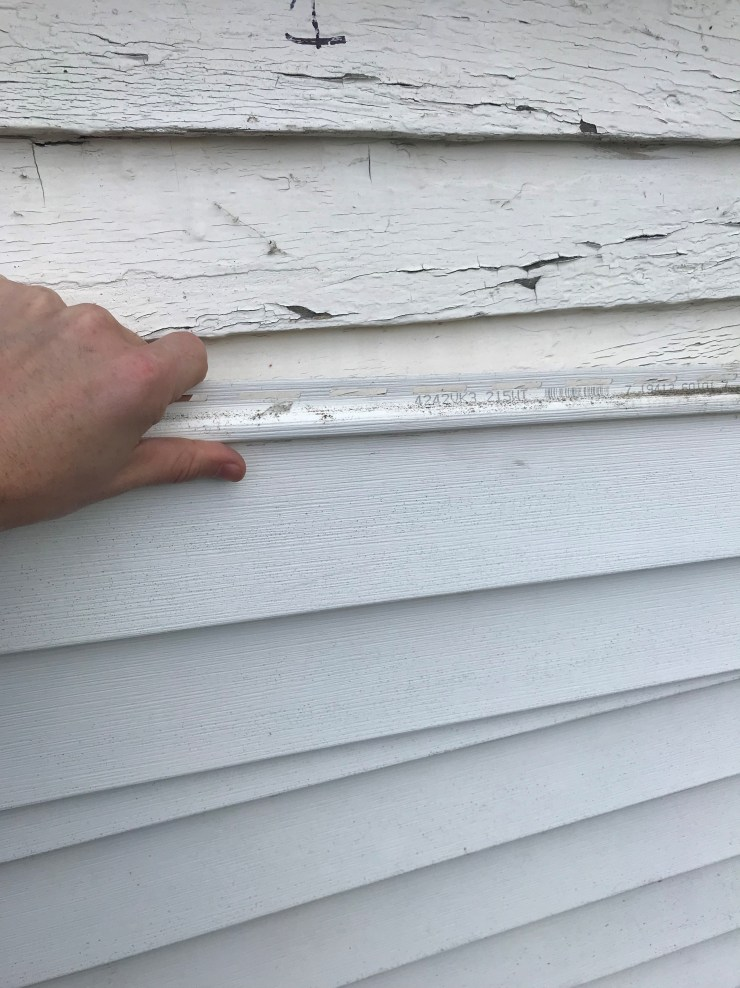 Push Down On Siding to Remove