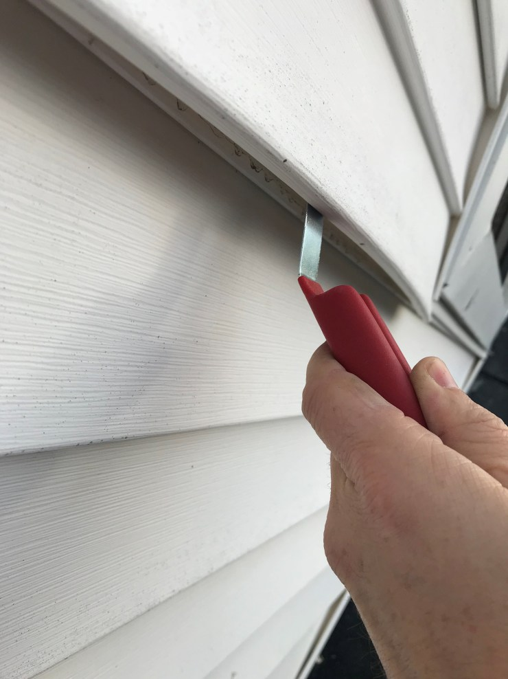 Using Tool To Remove Siding