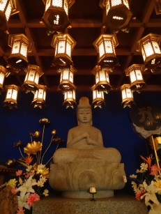 Ilumiated hall with buddha at the Daisho-in temple.