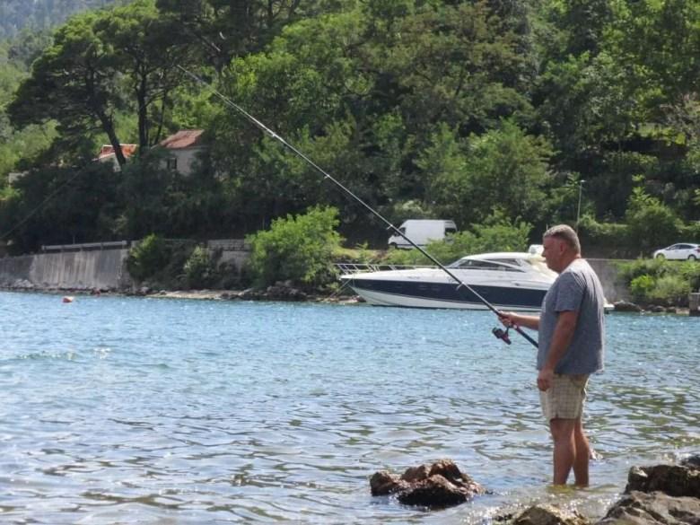Man fishing water sea