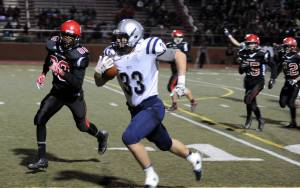 Carter Schnarr races to the end zone during the Panthers' 52-7 win over Harrison last Friday night