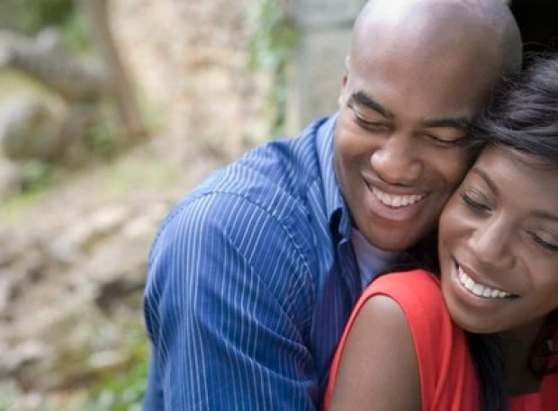 African American couple hugging outdoors --- Image by © ERproductions Ltd/Blend Images/Corbis
