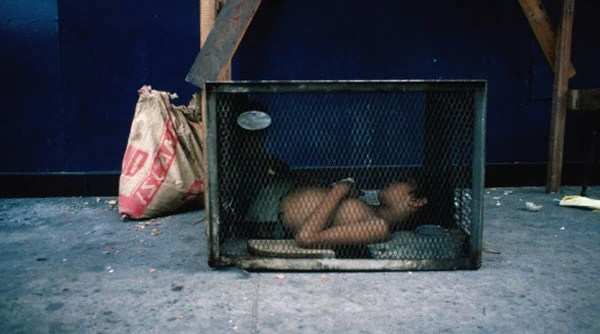 A child sleeping and living on the streets of Manila.
