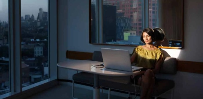 Businesswoman working late on laptop
