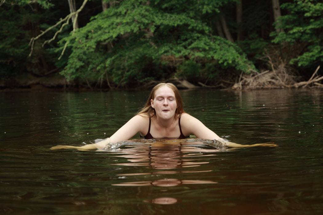 woman in body of water during day time