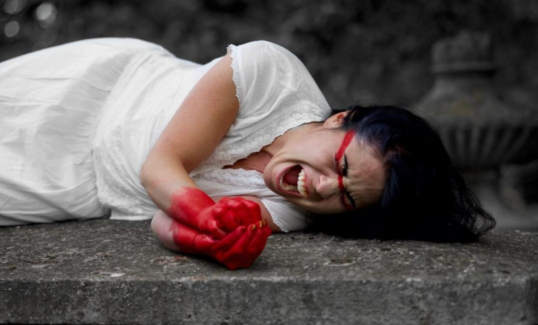 a woman stained with blood after a miscarriage