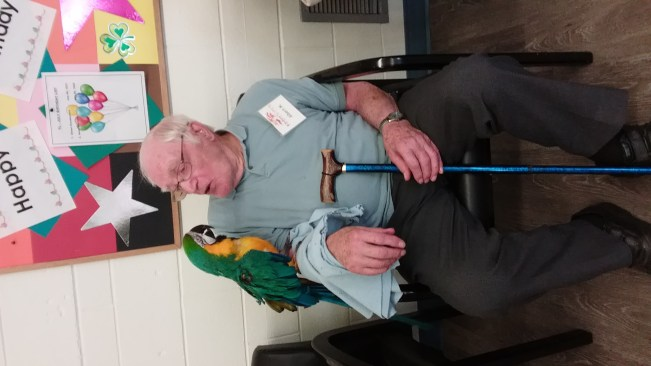 Dad with parrot at Fulton Eldercare
