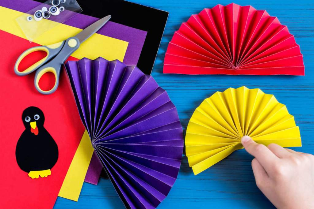 Step 7. make three colorful fans for tail