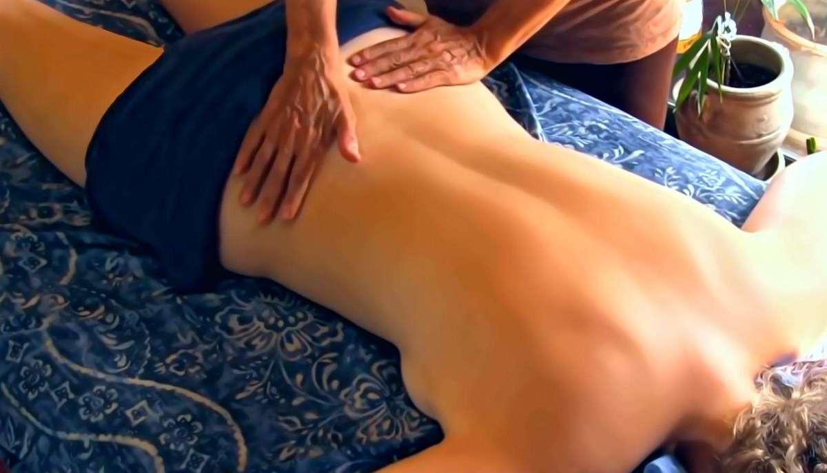 A lady having massage for arthritis