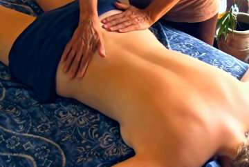 A lady having massage for arthritis