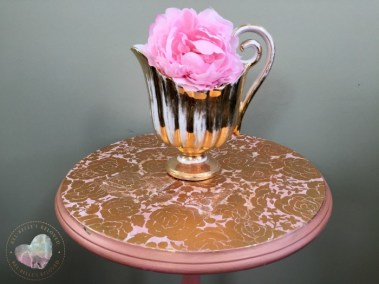Closeup of top decoupaged in gold roses