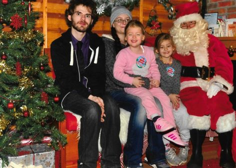 The girls, my brother and I with Santa at Rainforest Café