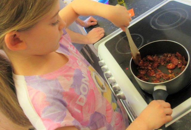 Eva cooking chicken paella