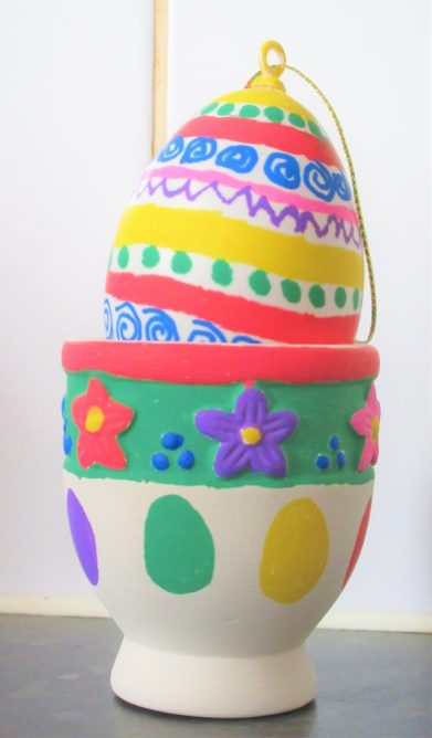Deocrated Easter Egg in Easter Egg Cup Using Posca Pens