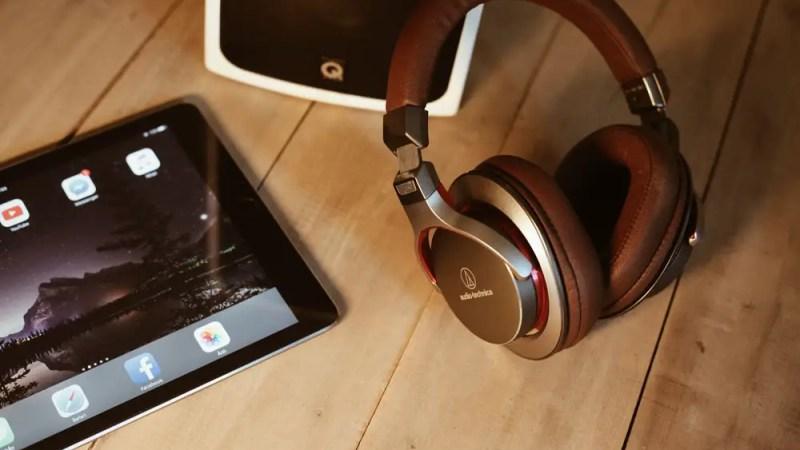 Audio Technica headphones next to an iPad